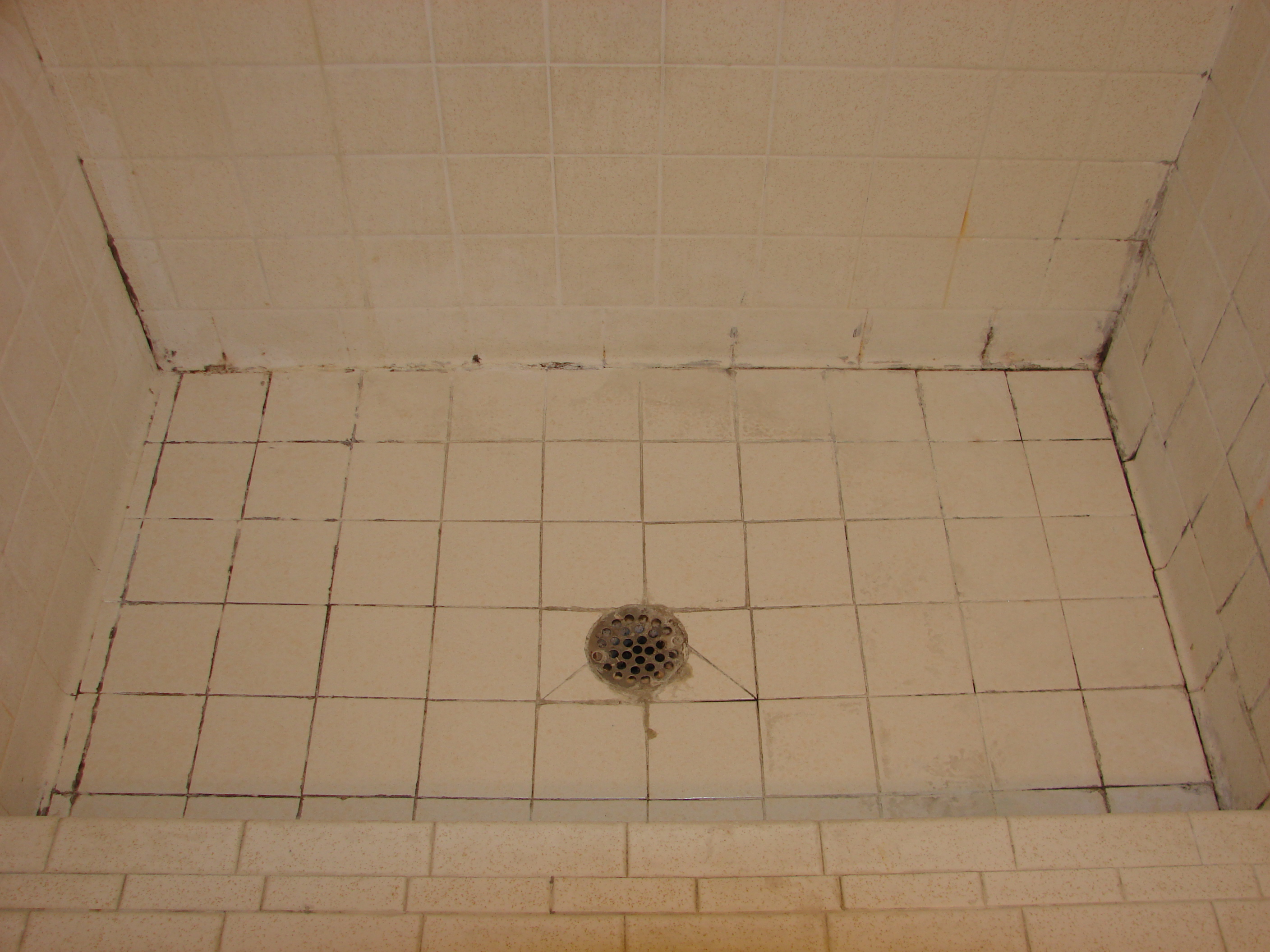 Regrouting bathroom floor tiles